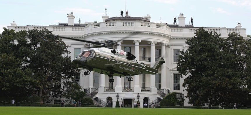 The White House with helicopter in foreground.
